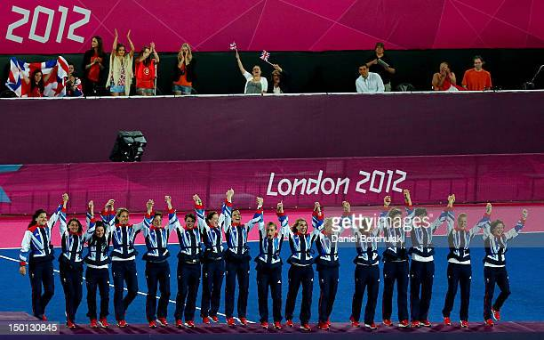 Team Great Britain celebrates with their bronze medals on the podium during the medal ceremony for the Women's Hockey on Day 14 of the London 2012...