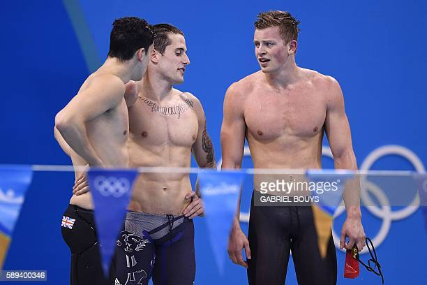 Team Great Britain Chris WalkerHebborn Adam Peaty and Guy James celebrate after winning the silver medal in the Men's swimming 4 x 100m Medley Relay...