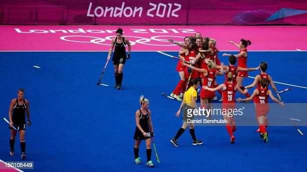 Team Great Britain huddles together in celebration of their 3-1 victory over team New Zealand during the Women's Hockey bronze medal match on Day 14...