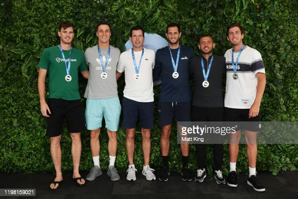 Team Great Britain pose after winning Group C and qualifying for the quarter finals during day six of the 2020 ATP Cup Group Stage at Ken Rosewall...