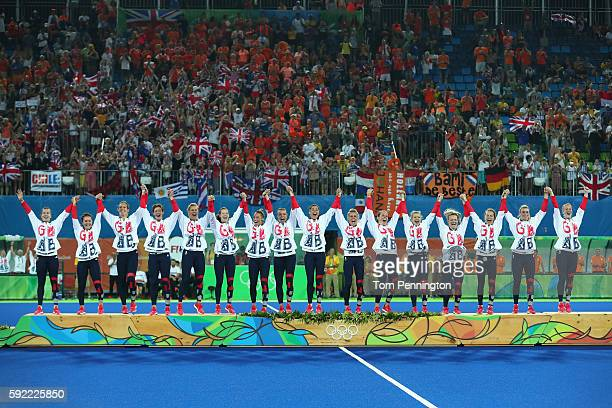Team Great Britain pose on the podium during the medal ceremony after defeating Netherlands in the Women's Gold Medal Match on Day 14 of the Rio 2016...