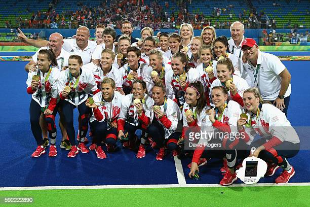 Team Great Britain pose with their gold medals after defeating Netherlands in the Women's Gold Medal Match on Day 14 of the Rio 2016 Olympic Games at...