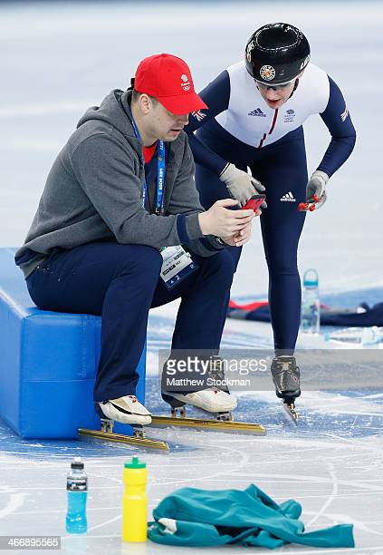 Team Great Britain Short Track Speed Skater Charlotte Gilmartin speaks to a coach during a practice session ahead of the Sochi 2014 Winter Olympics...