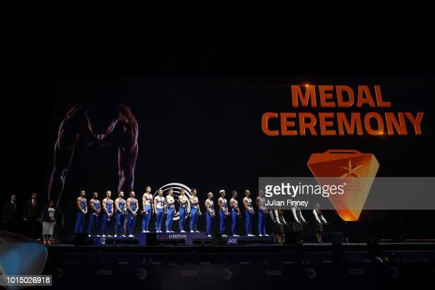 Team Great Britain Team Russia and Team France participate in a medal ceremony after the Men's Gymnastics Final on Day Ten of the European...