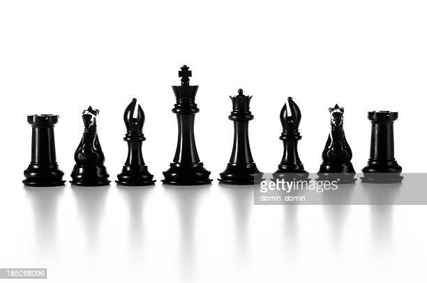 Team, group of black chess pieces in a raw isolated