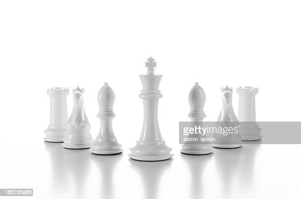 Team, group of white chess pieces isolated on white