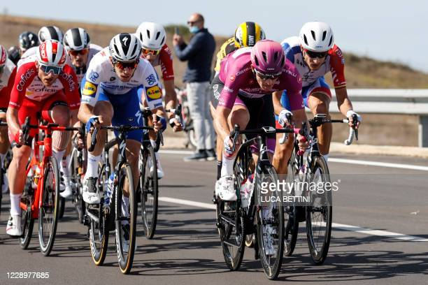 Team Groupama-FDJ France's rider Arnaud Demare wearing the Ciclamino Jersey, leader of point classification rides in front of the echelons during the...