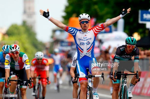 Team Groupama-FDJ rider France's Arnaud Demare celebrates as he finished first in the stage ten of the 102nd Giro d'Italia - Tour of Italy - cycle...