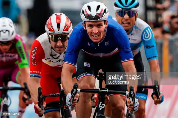 Team Groupama-FDJ rider France's Arnaud Demare crosses the finish line to win the 4th stage of the Giro d'Italia 2020 cycling race, a 140-kilometer...