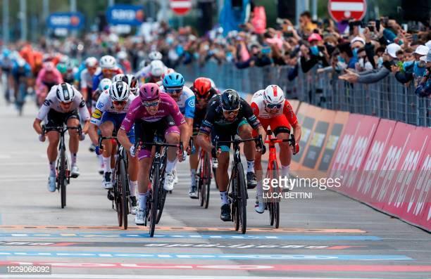Team Groupama-FDJ rider France's Arnaud Demare wearing the best sprinter's mauve jersey and Team Bora rider Slovakia's Peter Sagan sprint before...