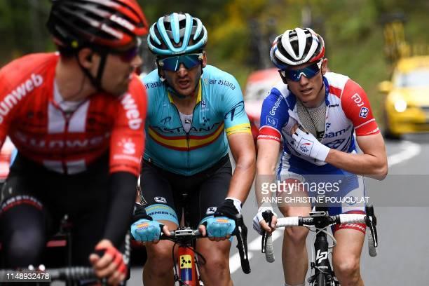 Team Groupama-FDJ rider France's David Gaudu rides behind Astana Pro Team rider Spain's Gorka Izaguirre and Team Sunweb rider Netherlands' Tom...