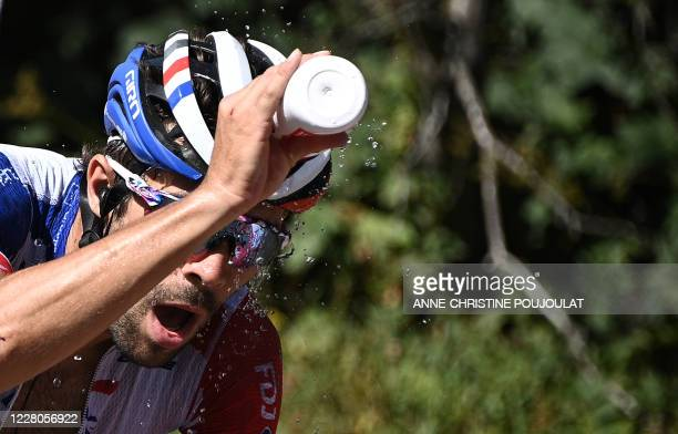 Team Groupama-FDJ rider France's Thibaut Pinot refresh himself as he rides during the fourth stage of the 72nd edition of the Criterium du Dauphine...