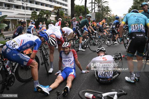 Team Groupama-FDJ rider France's Thibaut Pinot rests on the road after falling during the 1st stage of the 107th edition of the Tour de France...