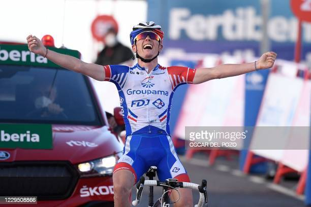 Team Groupama-FDJ's French rider David Gaudu celebrates as he crosses the finish-line of the 17th stage of the 2020 La Vuelta cycling tour of Spain,...