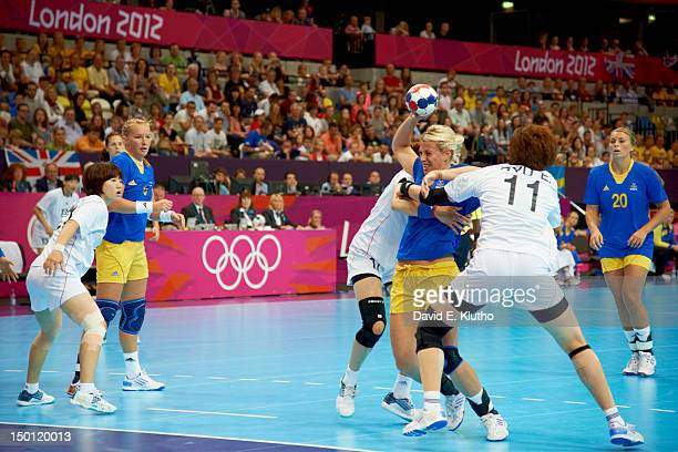2012 Summer Olympics Sweden Johanna Ahlm in action vs South Korea Eun Hee Ryu and Haein Sim during Women's Preliminary Round Group B at The Copper...