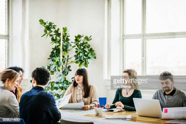 team having meeting in conference room - bottle green stock pictures, royalty-free photos & images