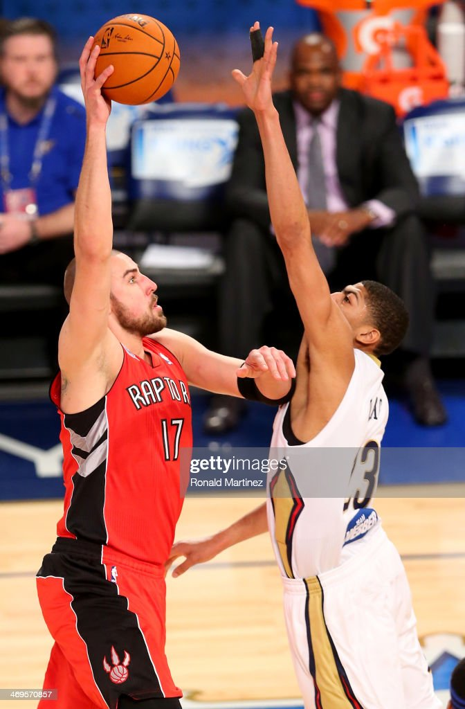 Team Hill's Jonas Valanciunas #17 of the Toronto Raptors takes a shot as Team Webber's Anthony Davis #23 of the New Orleans Pelcians defends during the BBVA Compass Rising Stars Challenge 2014 as part of the 2014 NBA Allstar Weekend at the Smoothie King Center on February 14, 2014 in New Orleans, Louisiana.
