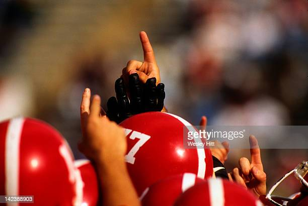 Team holding up a finger signifying 'No.1'