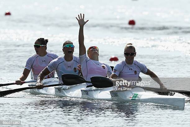 Team Hungary celebrates winning the gold medal in the Women's Kayak Four 500m Finals on Day 15 of the Rio 2016 Olympic Games at the Lagoa Stadium on...