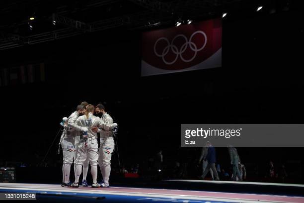 Team Hungary huddles prior to their match against Team United States in Men's Sabre Team Quarterfinal on day five of the Tokyo 2020 Olympic Games at...