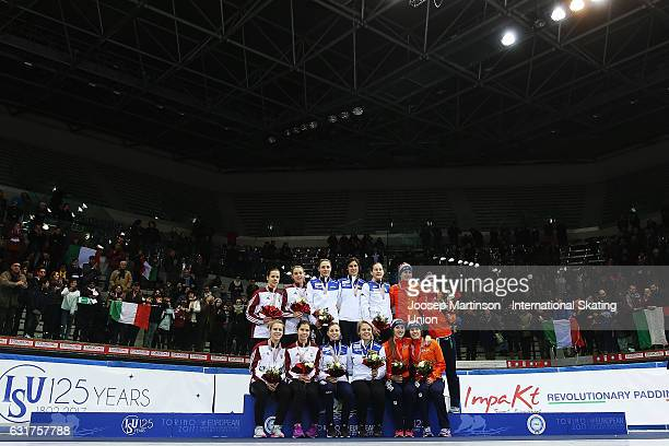 Team Hungary team Italy and team Netherlands pose in the Ladies 3000m relay medal ceremony during day 2 of the European Short Track Speed Skating...