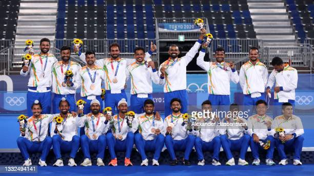 Team India celebrate with their Bronze Medals during the Victory Ceremony following the Men's Gold Medal match between Australia and Belgium on day...