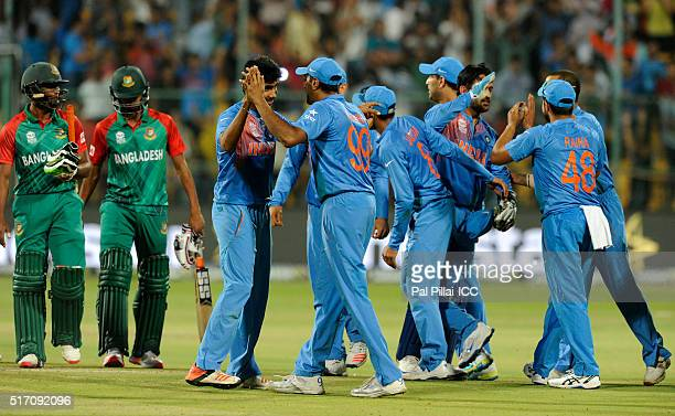 Team India celebrates after winning the ICC World Twenty20 India 2016 match between India and Bangladesh at the Chinnaswamy stadium on March 23 2016...