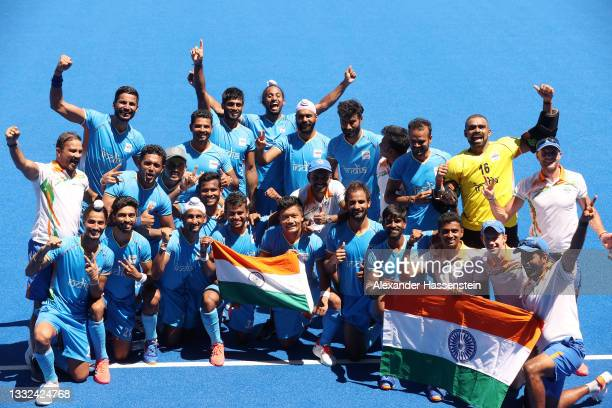 Team India pose for a picture after winning the Men's Bronze medal match between Germany and India on day thirteen of the Tokyo 2020 Olympic Games at...