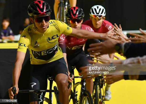Team Ineos' Egan Bernal of Colombia and his teammates greet spectators after the opening ceremony of the 2019 Tour de France Saitama criterium...