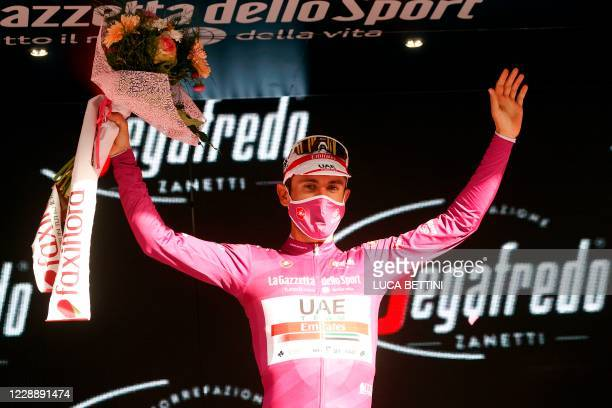 Team Ineos Grenadiers Italian rider Filippo Ganna, wearing the ciclamino jersey , celebrates on the podium of the second stage of the 2020 Giro...
