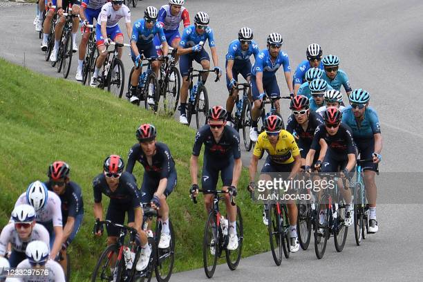 Team Ineos' Richie Porte of Australia wearing the overall leader's yellow jersey rides in the pack during the eighth stage of the 73rd edition of the...