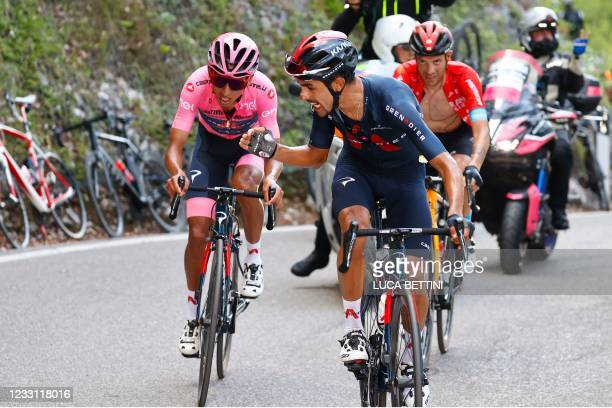 Team Ineos rider Colombia's Daniel Martinez encourages his teammate overall leader Team Ineos rider Colombia's Egan Bernal as they ride along with...