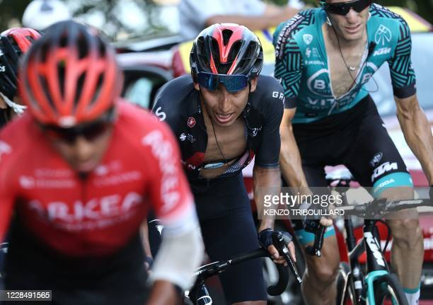 Team Ineos rider Colombia's Egan Bernal climbs the Grand Colombier pass behind the leader's group during the 15th stage of the 107th edition of the...