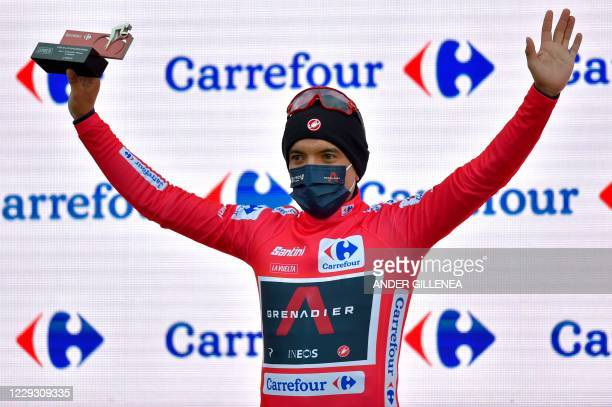 Team Ineos rider Ecuador's Richard Carapaz celebrates on the podium retaining the overall leader's red jersey after the 7th stage of the 2020 La...