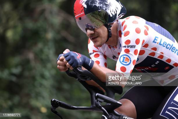 Team Ineos rider Ecuador's Richard Carapaz wearing the best climber's polka dot jersey rides during the 20th stage of the 107th edition of the Tour...