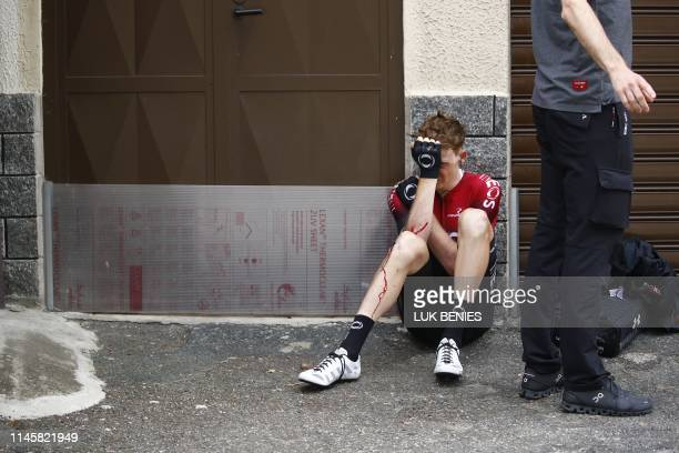 Team Ineos rider Great Britain's Tao Geoghegan Hart sits on the floor after falling during stage twelve of the 102nd Giro d'Italia - Tour of Italy -...