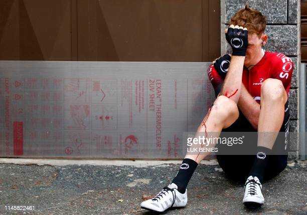 TOPSHOT Team Ineos rider Great Britain's Tao Geoghegan Hart sits on the floor after falling during stage twelve of the 102nd Giro d'Italia Tour of...