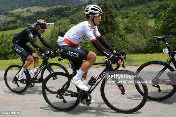 Team Ineos rider Poland's Michal Kwiatkowski rides followed by Team Ineos rider Netherlands' Wout Poels during the sixth stage of the 71st edition of...