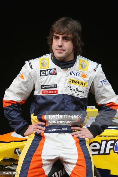Team ING Renault drivers Fernando Alonso of Spain poses with the new Renault R28 Formula 1 car in Renault Square on January 31 2008 in Paris, France