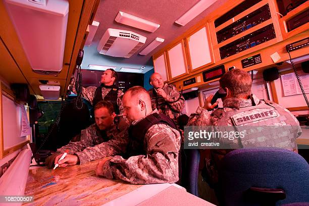 swat team inside command vehicle - task force stock pictures, royalty-free photos & images