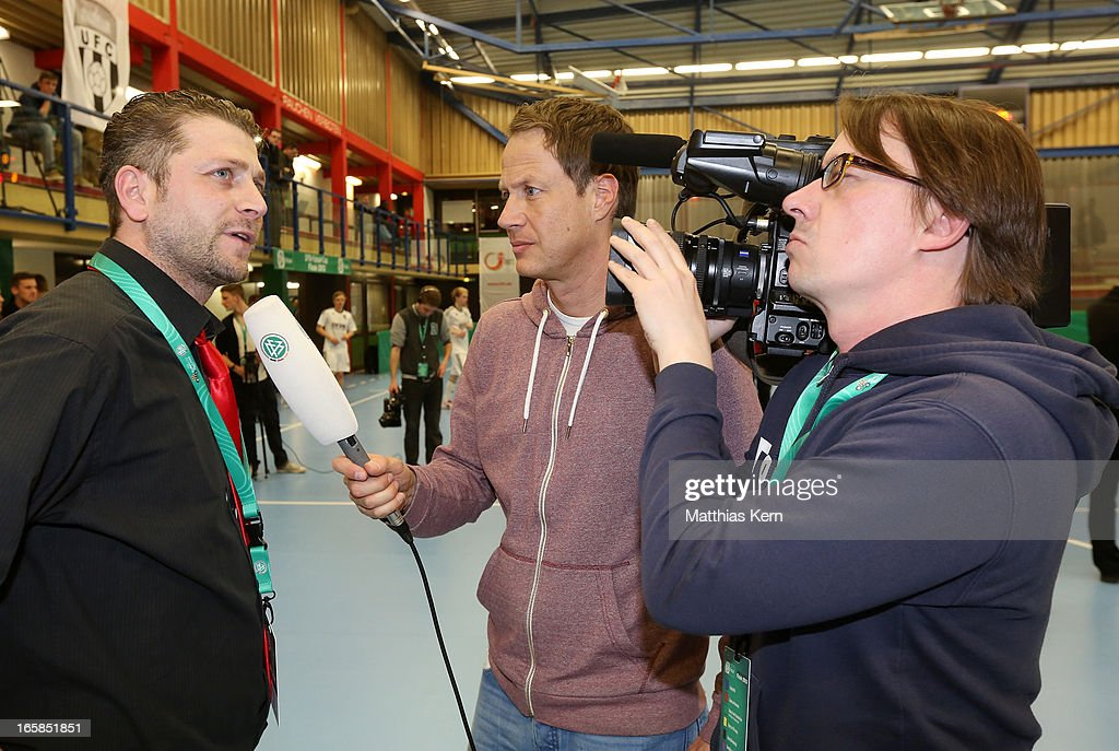 TV team interviews head coach Hakan Karadiken (L) of Hamburg after the DFB Futsal Cup final match between Hamburg Panthers and UFC Muenster at Sporthalle Wandsbek on April 6, 2013 in Hamburg, Germany.