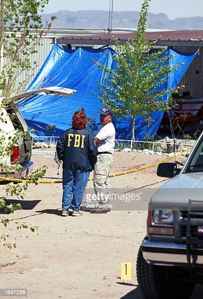 A FBI team investigates a trailer home where a woman says she was kidnapped and tortured over a threeday period in Elephant Butte New Mexico March 30...