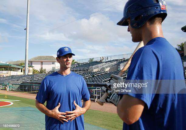 Team Israel player/coach Shawn Green talks with teammates during the workout for the World Baseball Classic Qualifier at Roger Dean Stadium on...