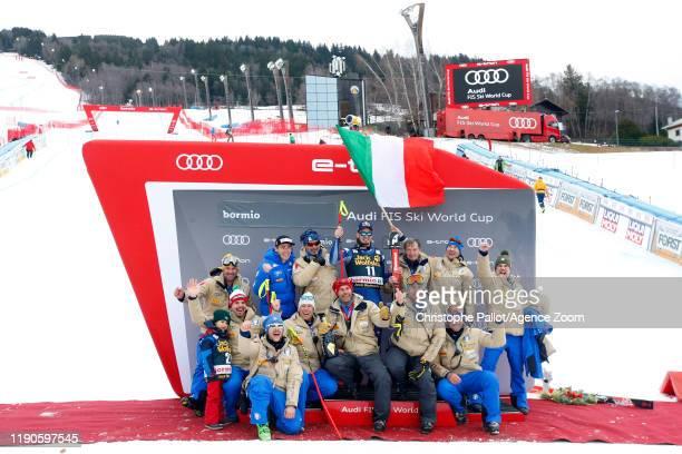 Team Italian celebrates during the Audi FIS Alpine Ski World Cup Men's Downhill on December 27, 2019 in Bormio Italy.