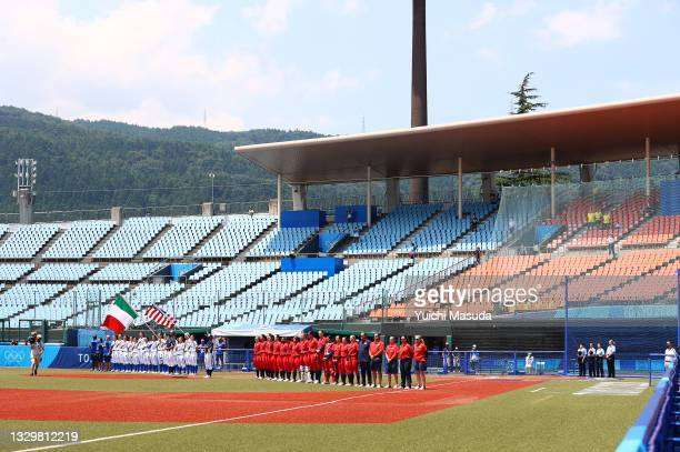 Team Italy and Team United States line up in the infield for pregame ceremonies during the Tokyo 2020 Olympic Games at Fukushima Azuma Baseball...