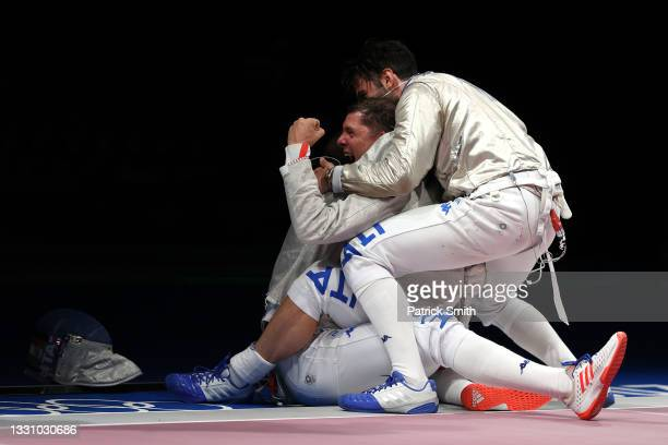 Team Italy celebrates after their win against Team Hungary to advance to the Gold Medal match in Men's Sabre Team on day five of the Tokyo 2020...