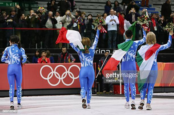 Team Italy celebrates after winning the bronze medal following a disqualification by China in the women's 3000m final speed skating during Day 12 of...