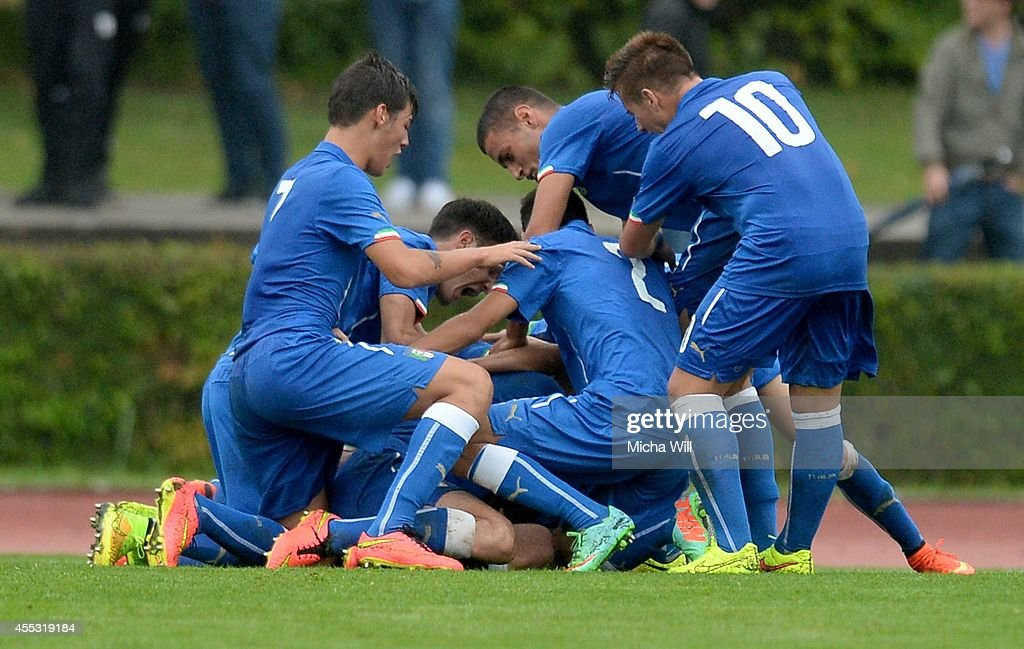 Team Italy celebrates it's second goal scored by Luca Matarese (covered) during the KOMM MIT tournament match between U17 Germany and U17 Italy on September 12, 2014 in Kelheim, Germany.