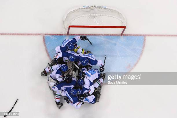 Team Italy celebrates the victory over Norway after penalty shoot out in the Ice Hockey Preliminary Round Group A game between Norway and Italy...