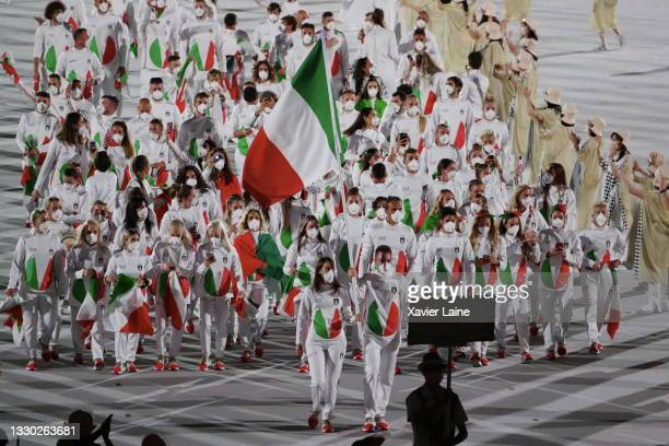 Team Italy walk in the parade during the Opening Ceremony of the Tokyo 2020 Olympic Games at Olympic Stadium on July 23, 2021 in Tokyo, Japan.